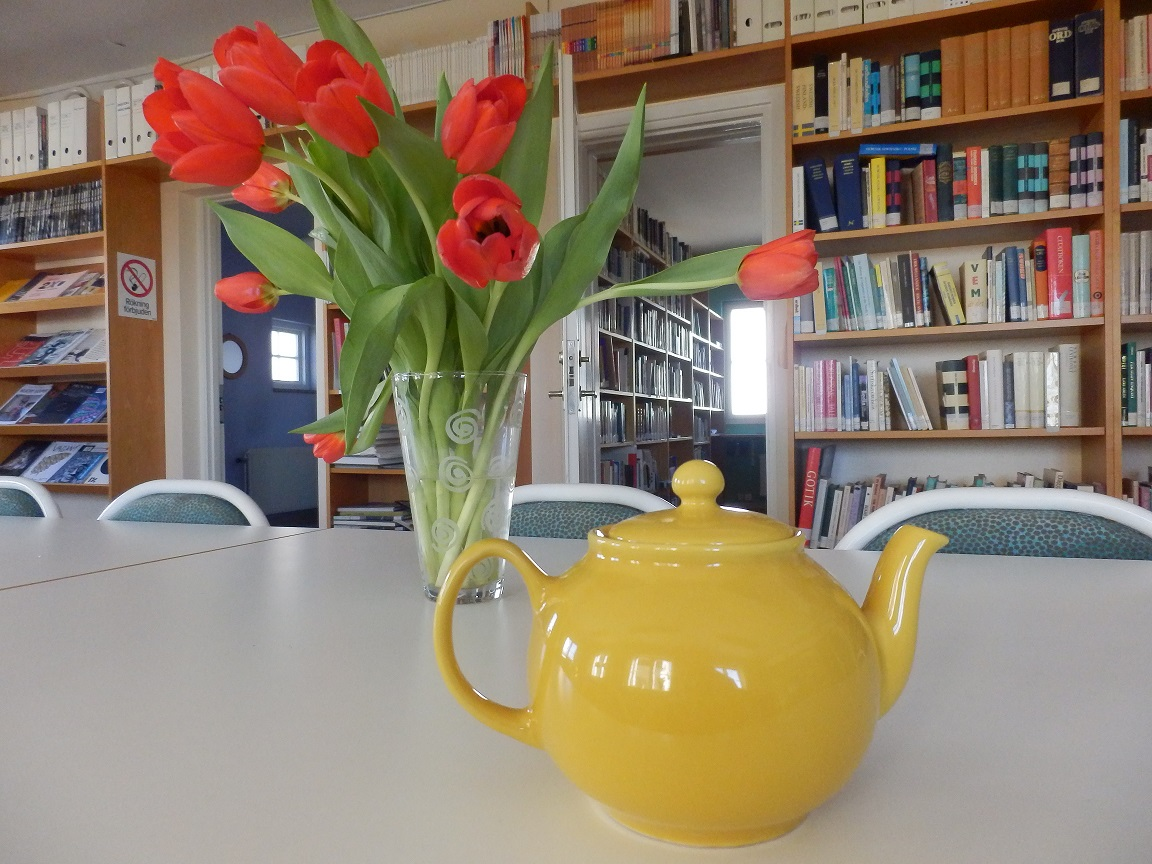Library of Baltic Centre for Writers and Translators with many books, tulips and teapot
